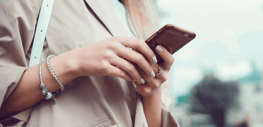 girl holding phone using social media