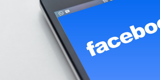 Close up of Facebook logo on a mobile phone.