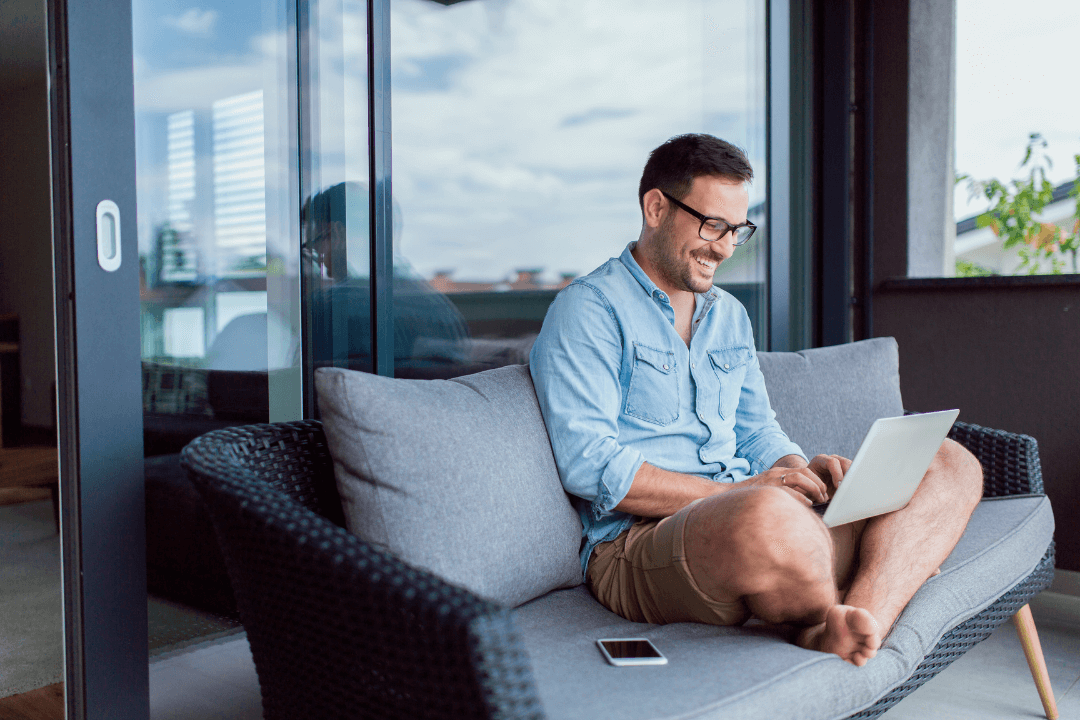A man working from home on his balcony