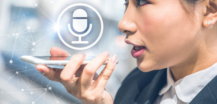 Women speaking into a smartphone with a microphone icon