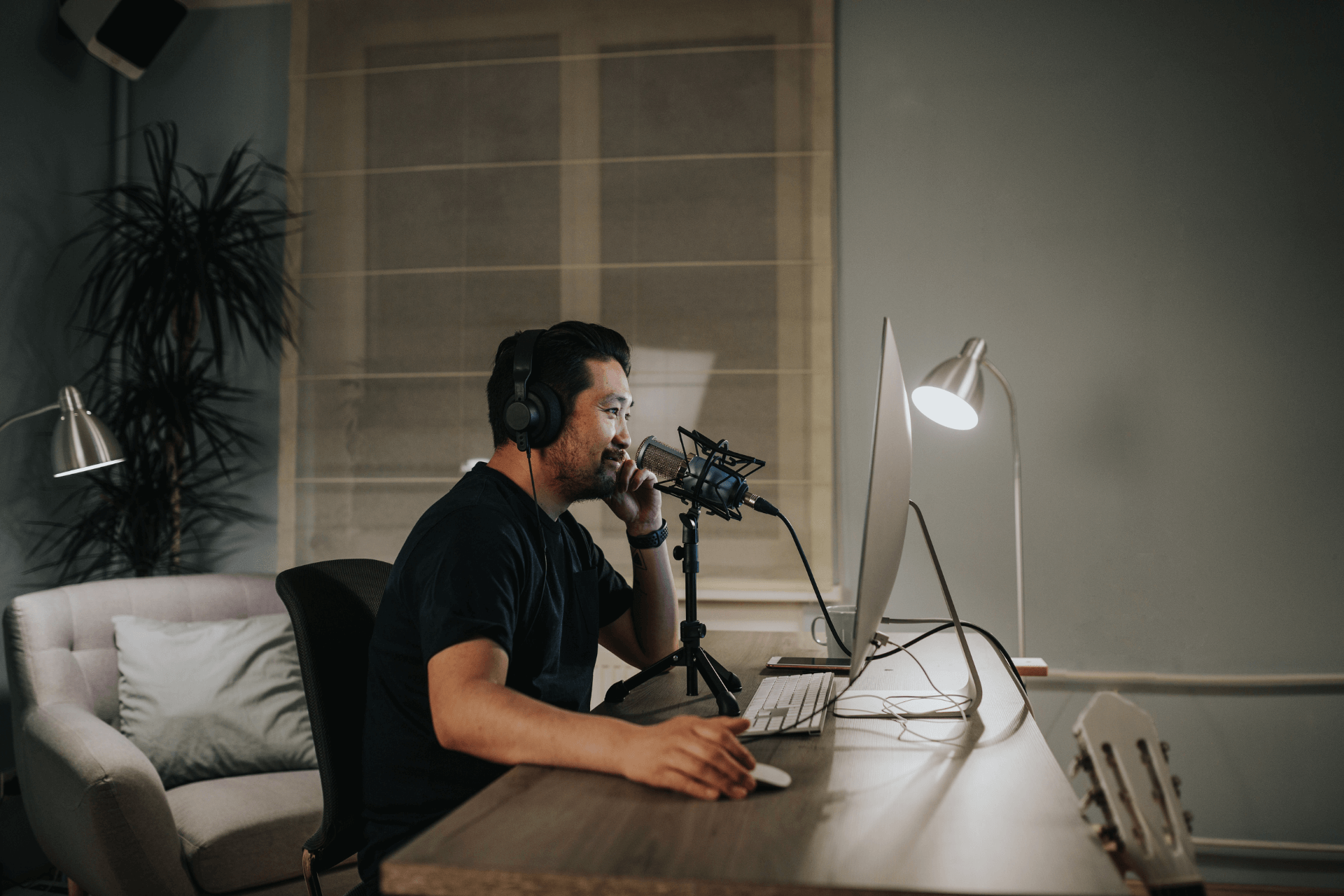 A man records a podcast repurposed from an old blog post