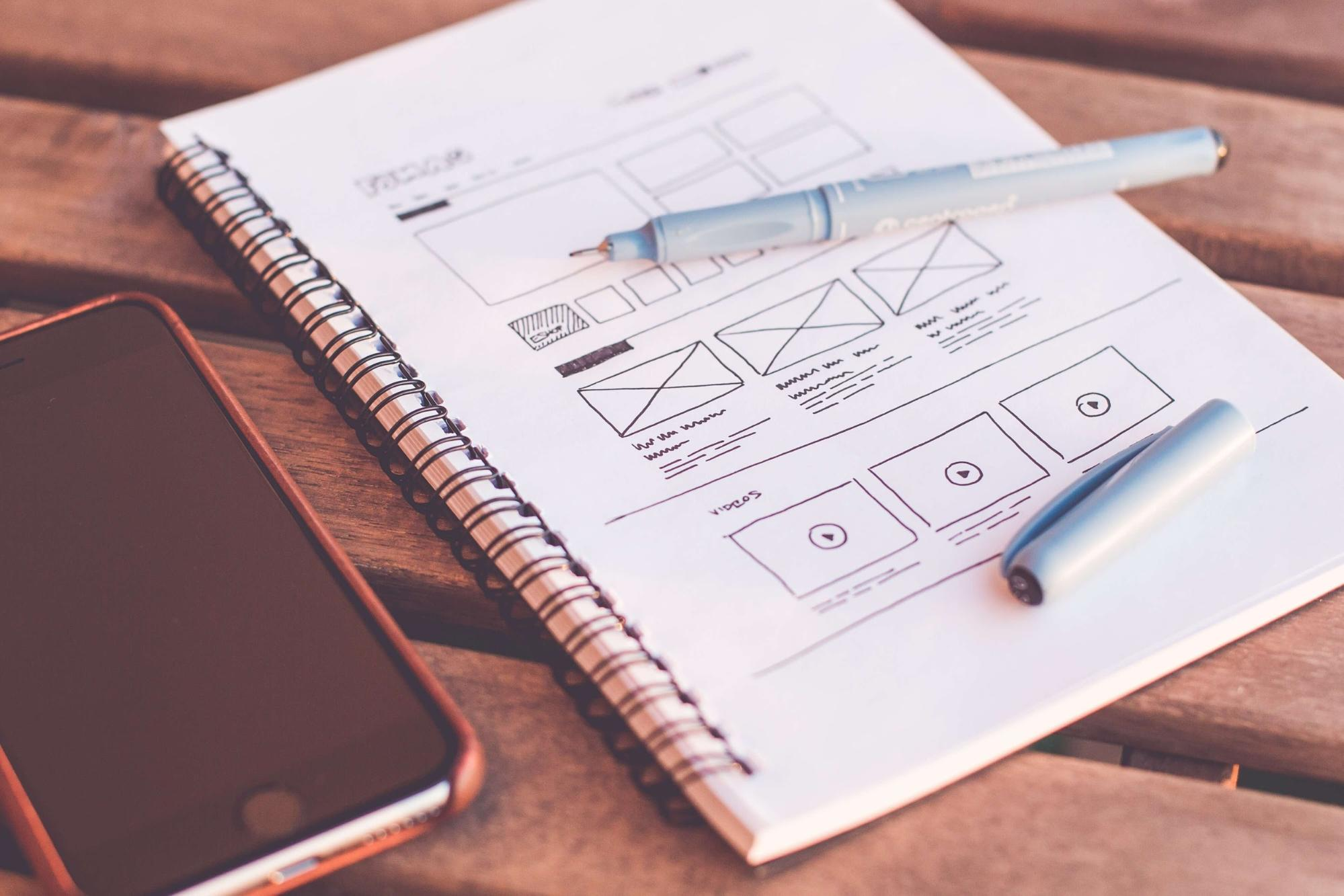 A notebook mapping out website design