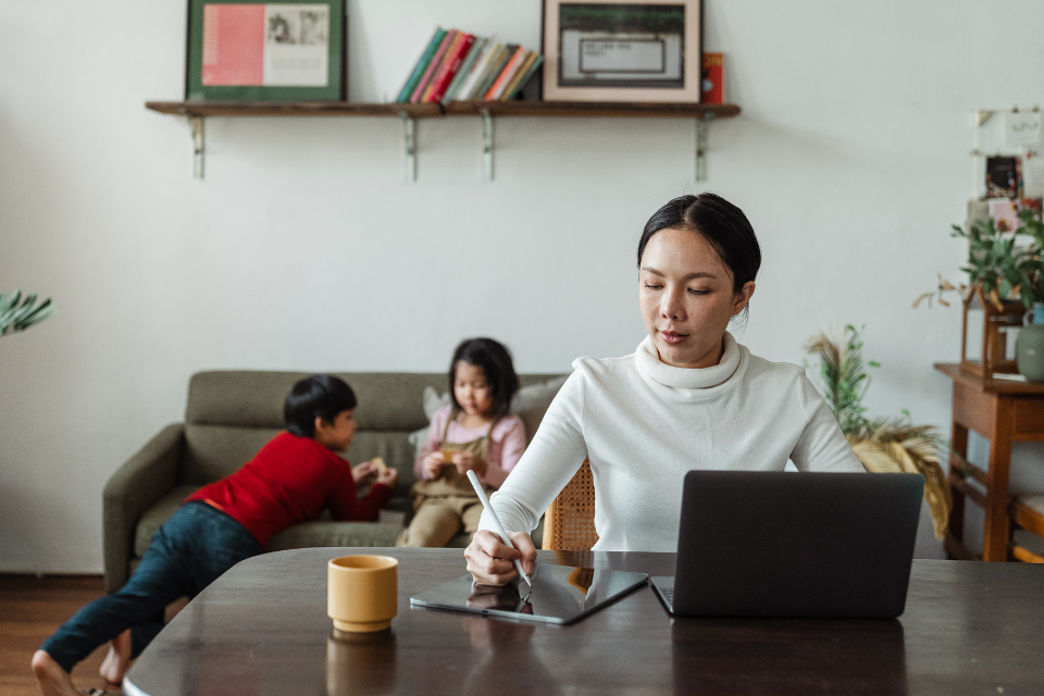 A woman working remotely from home using the cloud