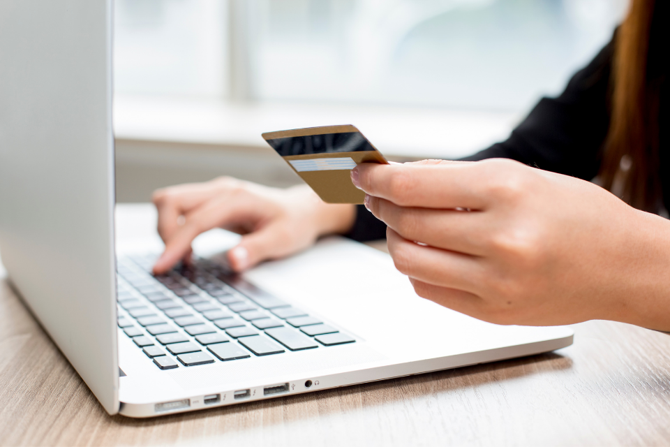 A person making an online payment using cloud technology
