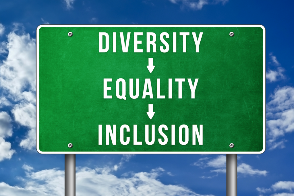 """A road sign that reads """"diversity"""", """"equality"""", and """"inclusion""""."""