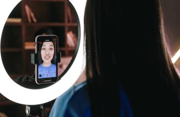 Girl filming TikTok video with ring light