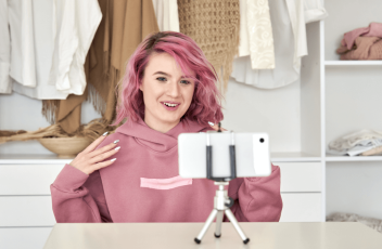 A Zoomer recording a video in their closet